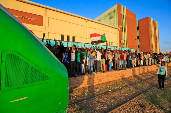 Sudanese protesters wait at a train station in Khartoum to board a train to Atbara on December 19, 2019 to celebrate the one-year anniversary of their protest movement that brought down Omar al-Bashir last April after a thirty-year rule.