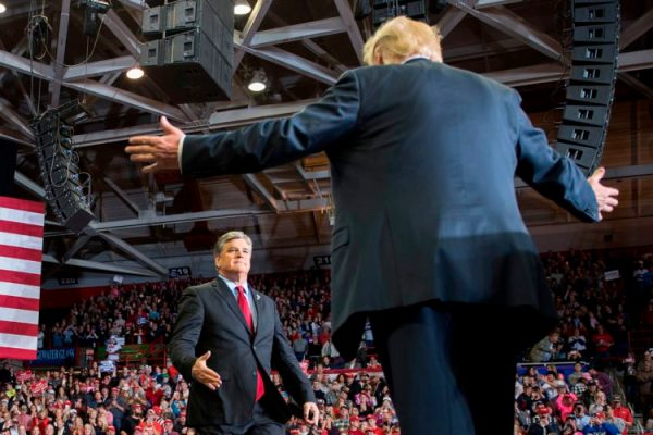 US President Donald Trump greets talk show host Sean Hannity at a Make America Great Again rally in Cape Girardeau, Missouri on November 5, 2018. (Jim Watson/AFP via Getty Images)