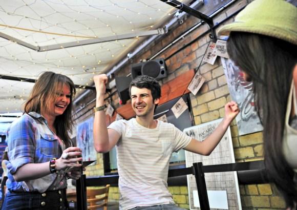 Man celebrating winning a game a Bacardi event.