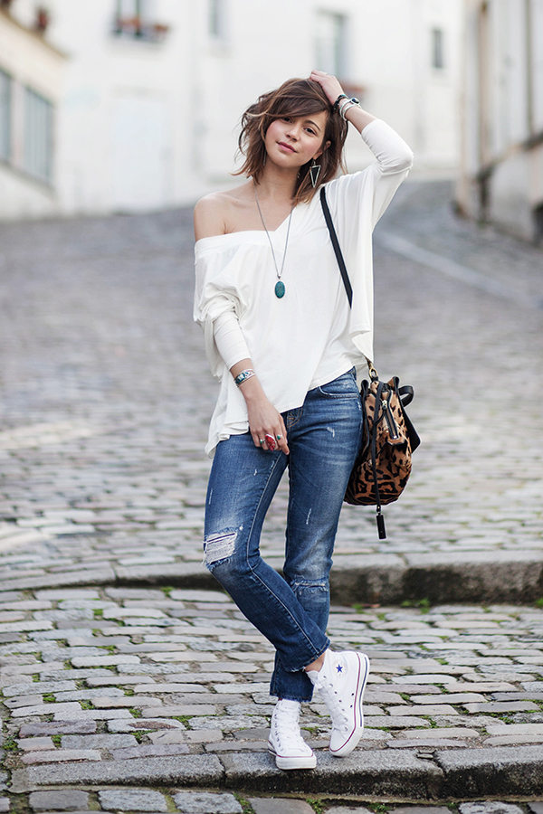 Wearing a pair of hi-top converse with distressed jeans and an off the shoulder top like Zoé Alalouch will give you a hot spring style. This look is casual but stylish, and won't cost you the bank! Top: Luie, Jeans: Zara, Shoes: Converse.