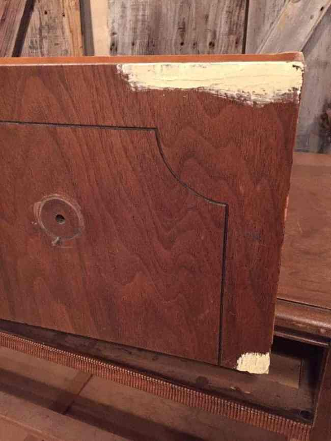 Filling in damage on drawers.