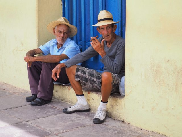 Locals Watching The World Go By