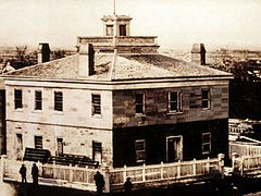 The Council House, destroyed by a fire explosion in 1883, sat where the Beneficial Life Tower is located today, on the corner of Salt Lake City's South Temple and Main Streets.
