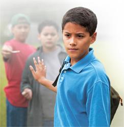 A boy refusing temptation from classmates