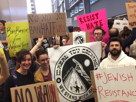 """signs include """"#JewishResistance"""" and """"Mazal Tov Cocktails"""""""