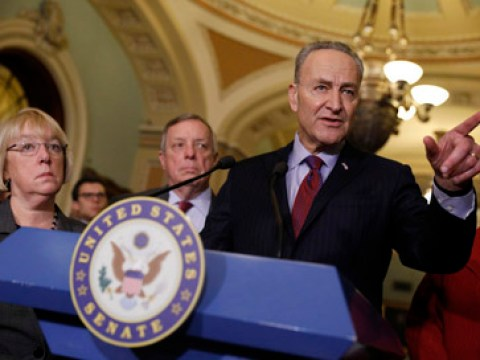 schumer speaking at a podium with the senate seal on it