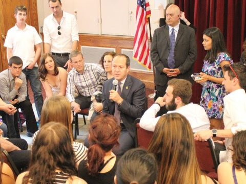 Barkat sits huddled in a circle speaking with other students