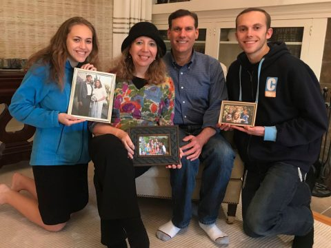 (From left) Moriah, Shacharit, Justin and Ari Rosenthal in their Piedmont rental with replacement family photos donated by friends, April 2018. (Photo/Sue Fishkoff)