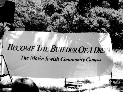 "black and white: a sign says ""Become the building of a dream: the Marin Jewish Community Campus"