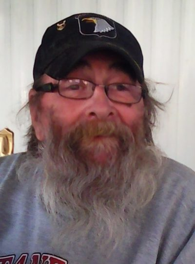 an older man with a beard, wearing glasses and a baseball hat