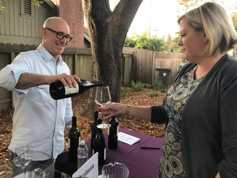 Winemaker Drew Neiman of Neiman Cellars pours wine for a guest. (Photo/Alix Wall)