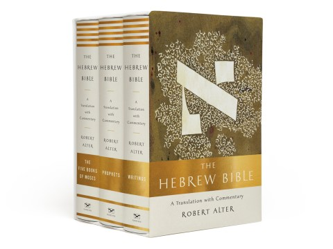 gold and white boxed set with artwork of an aleph on the front