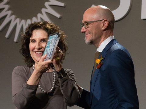 Anita Friedman accepting Silver SPUR award