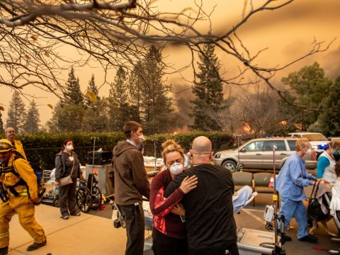 Nurse Cassie Lerossignol hugs a coworker at the Feather River Hospital, which had to evacuate on Nov. 8 as the Camp Fire burned through Paradise. (Photo/Courtesy Noah Berger-Associated Press)