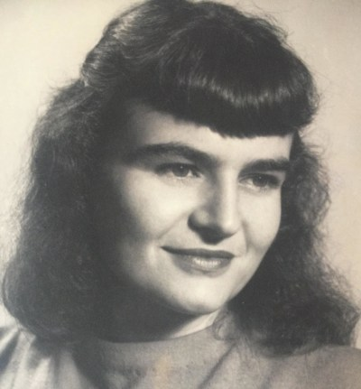 an old photo of a dark-haired woman