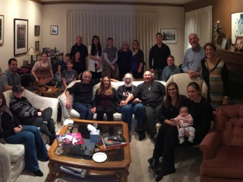 a large group of people gathered in a living room