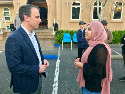 Assemblyman Marc Levine speaks with Khadija Hansia, a member of the Islamic Center of Mill Valley who helped organize the March 15, 2019, vigil for victims of the mosque shootings in New Zealand (Photo/Arno Rosenfeld)