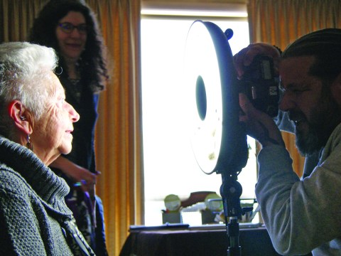 Luigi Toscano during photo session with local Holocaust survivor Anne Marie Yellin.