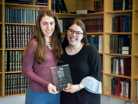 Kehillah Jewish High School students Joy Cheskin and Dahlia Soussan with their Moot Beit Din trophy
