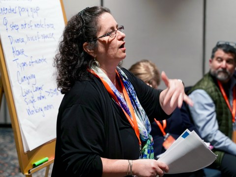 Naomi Tucker of Shalom Bayit speaks at the National Convening on Jewish Poverty in San Francisco, March 19. (Photo/Courtesy Harry and JeanetteWeinbergFoundation)