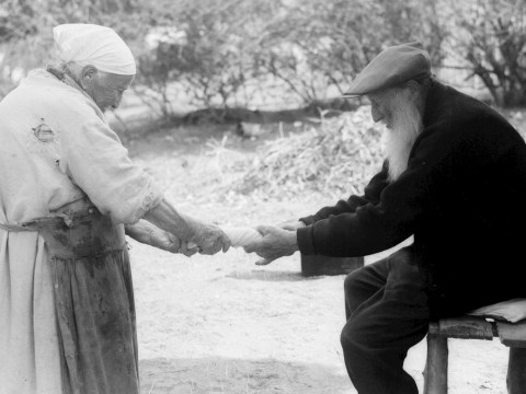 This charming picture of an elderly couple holding hands in their backyard was captured in 1933 by Zoltan Kluger, a famous photographer of pre-State Israel.