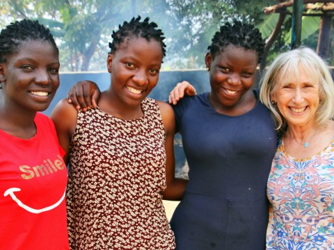 Joanne Greene poses with Sara, Binah and Deborah Nambozo, the nieces of Rabbi Gershom Sizomu, the leader of Uganda's Abayudaya Jewish community. (Photo/Fred Greene)