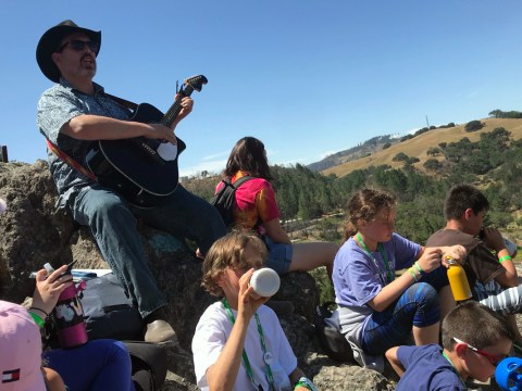 Rabbi David Young of Congregation B'nai Tzedek in Fountain Valley leads campers in song from the top of the iconic Camp Newman star. (Photo/Alaina Yoakum)