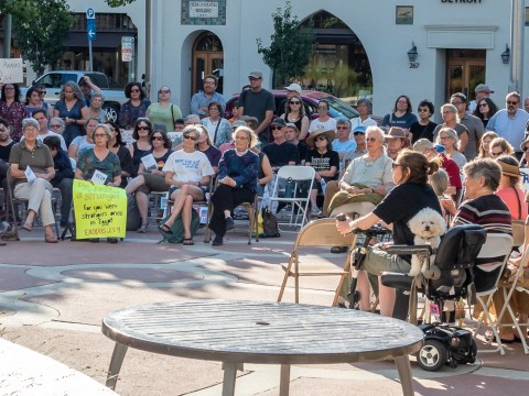 Rabbi Amy Eilberg speaks at an Aug. 11 protest in front of Palo Alto City Hall. (Photo/Courtesy Bend the Arc)