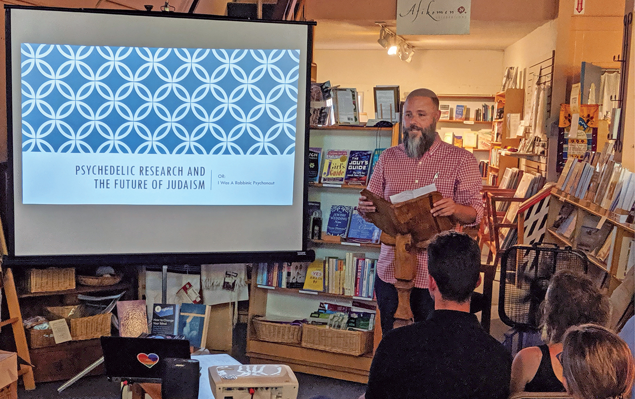 """Rabbi Zac Kamenetz speaking about """"Psychedelic Research and the Future of Judaism"""" at Afikomen Judaica, Aug. 14, 2019 (Photo/David A.M. Wilensky)"""