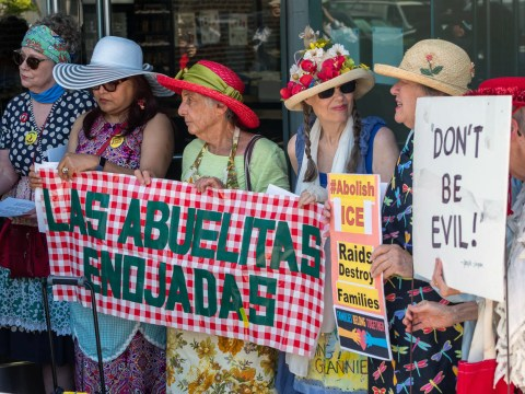 Ann Davidson (center, red hat) with the Raging Grannies protesting in Palo Alto at Palantir, a company with ties to ICE. (Photo/Jack Owicki)