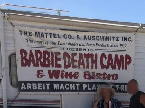 "The banner at the ""Barbie Death Camp & Wine Bistro."" Mattel, the makers of Barbie dolls, is not involved."