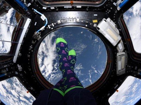 Jessica Meir's Hanukkah socks, seen far above earth. (JTA/Jessica Meir/Twitter)