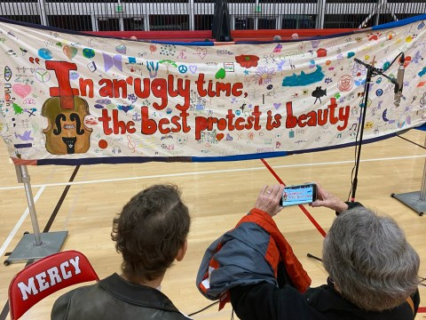 "A banner created by students at Mercy High School. ""We asked each student to think of their own gifts, talents… things that give them hope,"" teacher Elaina Legault said. (Gabriel Greschler)"