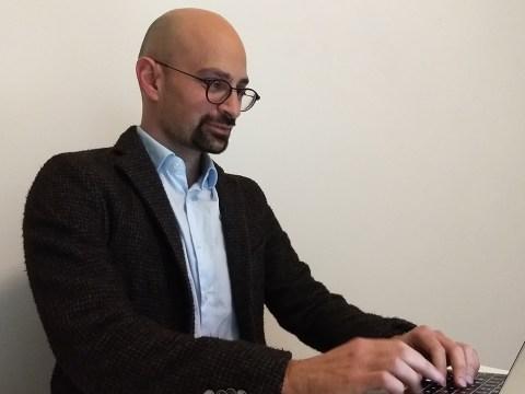 Italian Jewish journalist Daniel Reichel works at his Milan home, March 26, 2020. (JTA/COURTESY REICHEL)
