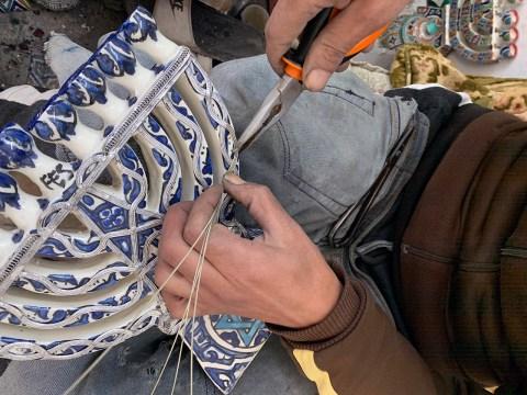 Working on a menorah at a ceramics factory in Fez. (SUE BARNETT)