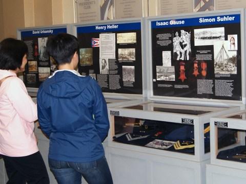 Visitors at the Jewish Medal of Honor exhibition in San Jose. (MAYA MIRSKY)
