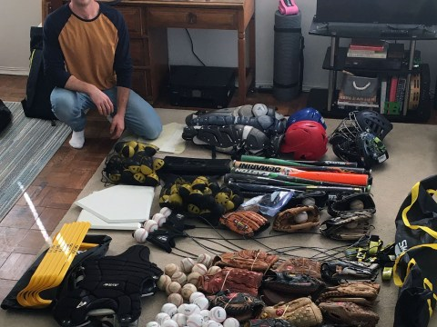 Nathan Gadye with some of the baseball equipment he brought to Israel from the U.S.