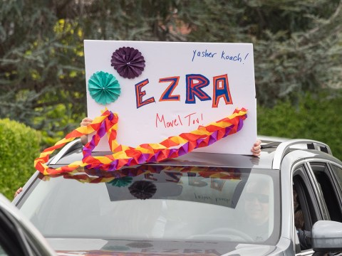 Many cars brought signs with messages of congratulations. (Photo/Norm Levin)