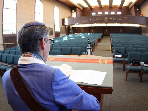 Rabbi Mark Bloom streams a live Shabbat service from Temple Beth Abraham in Oakland. (Photo/Michael Fox)