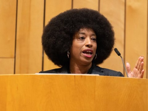a black woman speaking at a podium