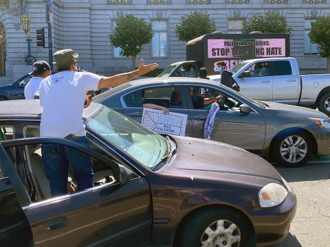 """A man protesting annexation at the July 1, 2020, """"Day of Rage"""" protest in front of San Francisco City Hall shouts toward a truck with a sign that reads, """"PALESTINIAN LEADERS: STOP TEACHING HATE."""" (Photo/Gabriel Greschler)"""