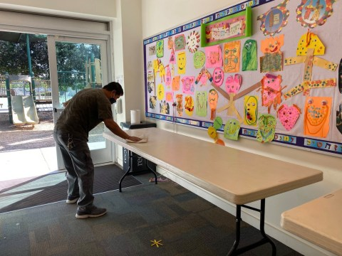 Gideon Hausner Jewish Day School's Facilities Manager Felix Gropar sanitizes a classroom. (Photo/Hillary Hazan-Glass)
