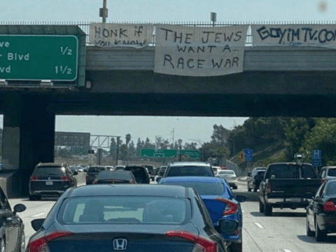 """A sign with the phrase """"The Jews Want A Race War"""" was hung from a Los Angeles interstate 405 highway overpass on Aug. 22. (Photo/JTA-Twitter-Siamak Kordestani)"""