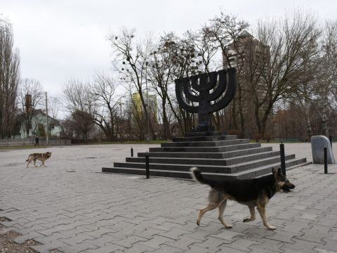 Stray dogs roam the Babyn Yar monument on March 14, 2016 in Kyiv, where Nazis and local collaborators murdered 30,000 Jews in 1941. (Photo/JTA-Cnaan Liphshiz)