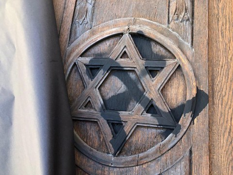 A swastika was found painted on Temple Sinai's carved wooden door in Oakland, Oct. 18, 2020. (Photo/Courtesy Temple Sinai)
