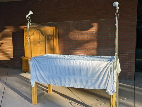 At Congregation B'nai Shalom, services are conducted from behind this table with transparent barriers affixed to it. (Photo/Rabbi Daniel Stein)