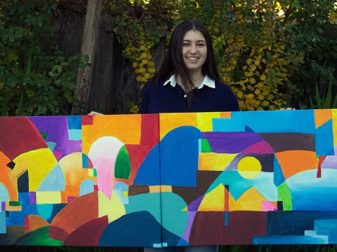 Rebecca Meshel with some of her shelter-in-place artwork.