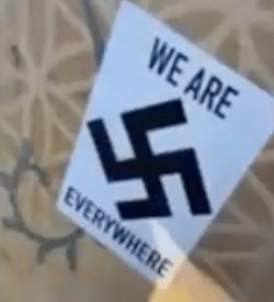 "the sticker has a swastika and the words ""we are everywhere"""