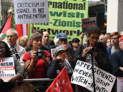Activists outside a meeting of the Labour National Executive Committee in London with signs protesting the IHRA definition of antisemitism, Sept. 4, 2018. (Photo/JTA-Stefan Rousseau-PA Images via Getty Images)