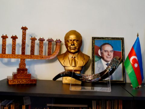 A view inside the office of the chairman of the religious community of the Azerbaijani Mountain Jews in Guba, 2013. On display is a menorah, a photograph and gold bust of Heydar Aliyev, the late founder of the new Azerbaijan, the Azerbaijan national flag and the Israeli flag. (Photo/JTA-Reza-Getty Images)